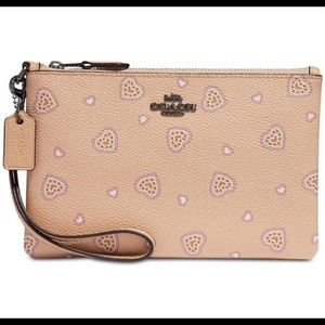 NWT Coach western hearts peach colored wristlet!!